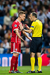 Joshua Kimmich of FC Bayern Munich talks to referee Cuneyt Cakir during the UEFA Champions League Semi-final 2nd leg match between Real Madrid and Bayern Munich at the Estadio Santiago Bernabeu on May 01 2018 in Madrid, Spain. Photo by Diego Souto / Power Sport Images