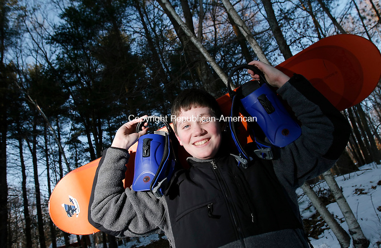 NEW MILFORD, CT, 02/04/08- 020409BZ01- Connor Wiseman, 13, poses in the yard of his New Milford home with his snowboard Wednesday.  Wisemanwas creditied with saving a 5-year-old skier who fell off a ski lift over the weekend.<br /> Jamison C. Bazinet Republican-American