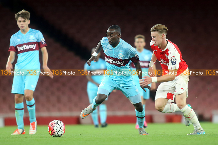 Nathan Mabi-Mavila of West Ham tries to shake off a challenge from Arsenal's Ben Sheaf