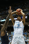 14 February 2016: North Carolina's Isaiah Hicks (4) shoots over Pittsburgh's Michael Young (2). The University of North Carolina Tar Heels hosted the University of Pittsburgh Panthers at the Dean E. Smith Center in Chapel Hill, North Carolina in a 2015-16 NCAA Division I Men's Basketball game. UNC won the game 85-64.