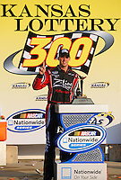Sept. 27, 2008; Kansas City, KS, USA; NASCAR Nationwide Series driver Denny Hamlin celebrates after winning the Kansas Lottery 300 at Kansas Speedway. Mandatory Credit: Mark J. Rebilas-