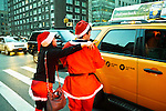 NEW YORK, NY - DECEMBER 15: Revelers dressed as Santa Claus try to hail a cab  during the annual SantaCon event December 15, 2012 in New York City. (Photo by Donald Bowers)