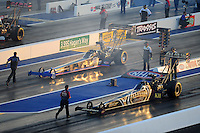 Apr. 13, 2012; Concord, NC, USA: NHRA top fuel dragster driver Khalid Albalooshi (near lane) backs up after his burnout alongside Pat Dakin during qualifying for the Four Wide Nationals at zMax Dragway. Mandatory Credit: Mark J. Rebilas-