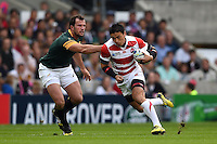 Ayumu Goromaru of Japan goes on the attack. Rugby World Cup Pool B match between South Africa and Japan on September 19, 2015 at the Brighton Community Stadium in Brighton, England. Photo by: Patrick Khachfe / Stewart Communications