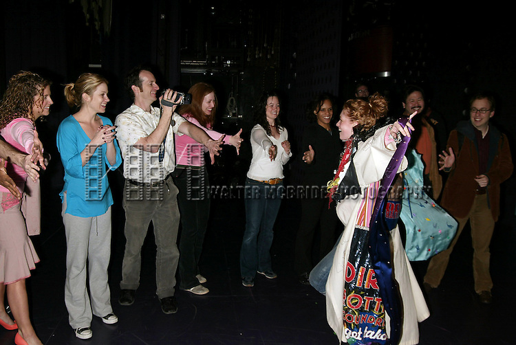 Dylis Croman .( Gypsy Robe winner for SWEET CHARITY ) with Alexis Carra, Denis O'Hare9with video camera), Christina Applegate, Mylinda Hull and cast members .Attending the Opening Night Gypsy Robe Ceremony for the Broadway Revival,  SWEET CHARITY at the Al Hirschfeld Theatre in New York City..May 4. 2005.© Walter McBride /