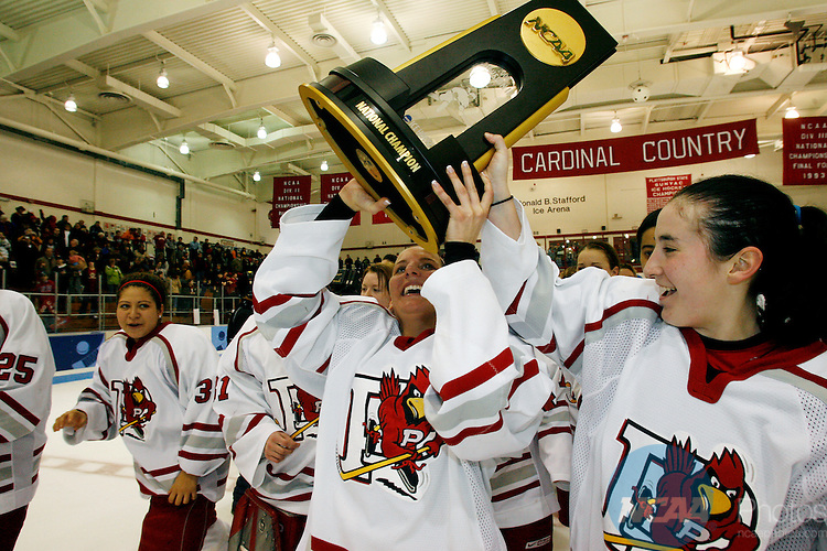22 MAR 2008: Plattsburgh State's Julie Devereux (21,center) and teammate Claire O'Connor (27, right) raise the championship trophy following the Division III Women's Ice Hockey Championship held at Stafford Ice Arena in Plattsburgh,NY. Plattsburgh defeated Manhattanville 3-2. Nancie Battaglia/NCAA Photos