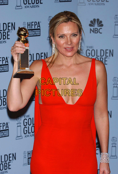KIM CATTRALL.60th Golden Globe Awards, Los Angeles, USA..January 19th, 2003.half length award trophy red cleavage low cut dress .CAP/PL.©Phil Loftus/Capital Pictures