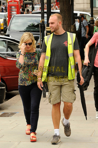 Amy Poehler<br /> spotted filming on the set of 'Parks and Recreation', London, England.<br /> 28th July 2013<br /> full length green pattern top sunglasses shades jeans denim shorts neon vest<br /> CAP/IA<br /> &copy;Ian Allis/Capital Pictures