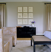 A vintage black cabinet designed by Edward Wormley stands beneath an artwork by Alex Katz in the master bedroom
