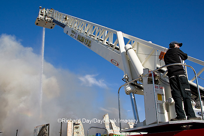 63818-022.10 Firefighters extinguishing warehouse fire using aerial ladder truck, Salem, IL