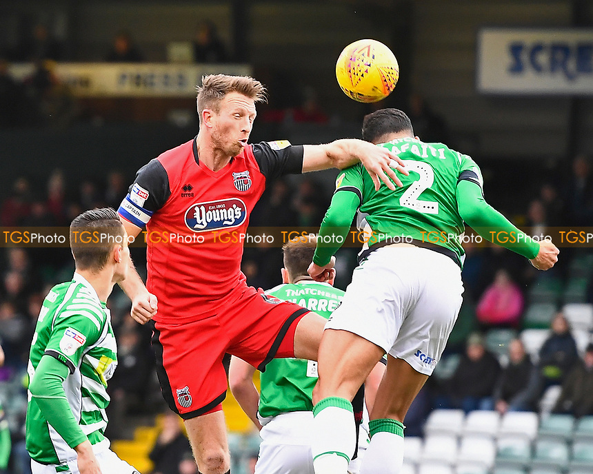 Danny Collins of Grimsby Town wins a header from Adel Gafaiti of Yeovil Town during Yeovil Town vs Grimsby Town, Sky Bet EFL League 2 Football at Huish Park on 9th February 2019