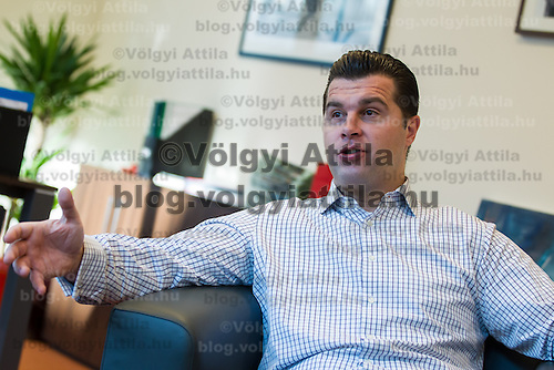 Krisztian Hliniczky founder and CEO of Perfectum Consulting talks during an interview for business daily Napi Gazdasag in his office in Budapest, Hungary on January 27, 2012. ATTILA VOLGYI