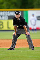Base umpire Richard Riley handles the calls on the bases during the Appalachian League game between the Pulaski Mariners and the Burlington Royals at Burlington Athletic Park on June20 2013 in Burlington, North Carolina.  The Royals defeated the Mariners 2-1 in 13 innings.  (Brian Westerholt/Four Seam Images)