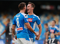 19th July 2020; Stadio San Paolo, Naples, Campania, Italy; Serie A Football, Napoli versus Udinese; Arkadiusz Milik of Napoli celebrates with team mate Ruiz after scoring in the 31st  minute for 1-1