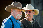Dick Fischer and Stan Dell'Orto talk cattle during calf marking and doctoring with the Dell'Orto outfit, Goodell Ranch, Paloma, Calif.