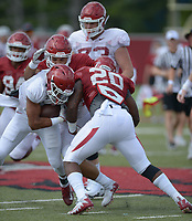NWA Democrat-Gazette/ANDY SHUPE<br /> Arkansas running back Rakeem Boyd (left) is hit by linebacker Giovanni LaFrance (20) Thursday, Aug. 9, 2018, during practice at the university's practice facility in Fayetteville. Visit nwadg.com/photos to see more photos from practice.