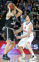 28.03.2012 Bilbao, Spain. Euroleague Playoff game 3. Picture show Axel Hervelle (L) and Viktor Khryapa (R) in action   during match betwen Gescrap BB againts CSKA Moscow at Bilbao Arena