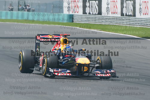 Red Bull Racing Formula One driver Sebastian Vettel of Germany drives during the Qualifyer of the Hungarian F1 Grand Prix in Mogyorod (about 20km north-east from Budapest), Hungary. Saturday, 30. July 2011. ATTILA VOLGYI