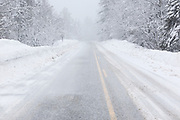 Kancamagus Highway (route 112), in the White Mountains, New Hampshire USA in blizzard conditions.