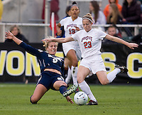 Lauren Steuer (23) of Ohio State has the ball tackled away from her by Lauren Fowlkes (9) of Notre Dame during the first game of the NCAA Women's College Cup at WakeMed Soccer Park in Cary, NC.  Notre Dame defeated Ohio State, 1-0.