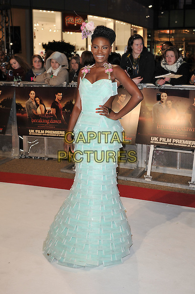Shingai Shoniwa of Noisettes .'The Twilight Saga: Breaking Dawn - Part 1' UK film premiere at Westfield Stratford City, London, England..16th November 2011.full length dress hand on hip green blue pastel halterneck layered layers flower in hair floral tulle.CAP/MAR.© Martin Harris/Capital Pictures.