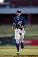 AZL Brewers shortstop Yeison Coca (7) jogs to the dugout between innings during a game against the AZL Cubs on August 6, 2017 at Sloan Park in Mesa, Arizona. AZL Cubs defeated the AZL Brewers 8-7. (Zachary Lucy/Four Seam Images)