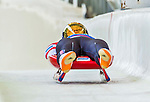 5 December 2014: Aidan Kelly, sliding for the USA, crosses the finish line on his first run, ending the day with a 7th place finish and a combined 2-run time of 1:43.349 in the Men's Competition at the Viessmann Luge World Cup, at the Olympic Sports Track in Lake Placid, New York, USA. Mandatory Credit: Ed Wolfstein Photo *** RAW (NEF) Image File Available ***