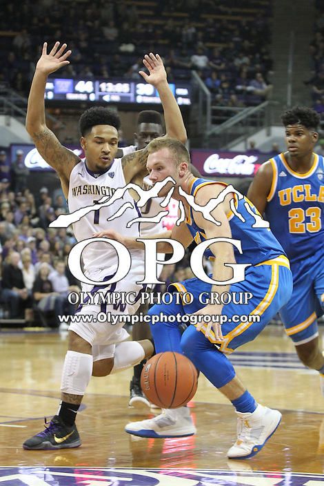 JAN 1, 2016:  UCLA's #20 Bryce Alford looks for an opening to the basket against Washington's #1 David Crisp.  Washington defeated #25 ranked UCLA 96-93 in double overtime at Alaska Airlines Arena in Seattle, WA.