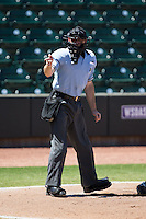 Home plate umpire Skyler Shown makes a strike call during the Carolina League game between the Lynchburg Hillcats and the Winston-Salem Dash at BB&T Ballpark on August 2, 2015 in Winston-Salem, North Carolina.  The Hillcats defeated the Dash 8-3.  (Brian Westerholt/Four Seam Images)