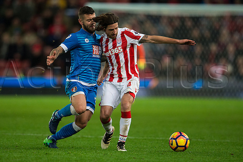 19.11.2016. Bet365 Stadium, Stoke, England. Premier League Football. Stoke City versus AFC Bournemouth. Stoke City midfielder Joe Allen is tackled by Bournemouth midfielder Jack Wilshere.