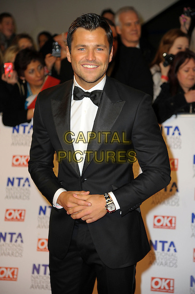 Mark Wright.arrivals at The National Television Awards, O2 Greenwich, London, England. 25th January 2012.NTA NTAS half length black white bow tie tuxedo .CAP/CAS.©Bob Cass/Capital Pictures.