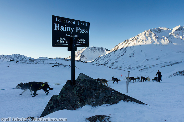 Gerry Willomitzer passes the summit sign of Rainy Pass in the Alaska Range during the  2011 Iditarod.