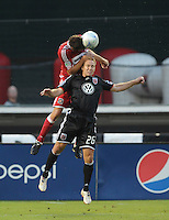 DC United defender Bryan Namoff (26) tries to head the ball against Chicago Fire forward Brian McBride (20) .  DC United defeated the Chicago Fire 2-1  at  RFK Stadium, Saturday June 13, 2009.