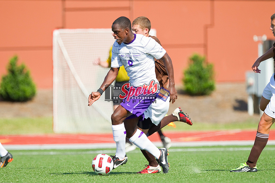 Fejiro Okiomah #9 of the High Point Panthers dribbles the ball against the St. Bonaventure Bonnies at Vert Track, Soccer & Lacrosse Stadium on September 11, 2011 in High Point, North Carolina.   (Brian Westerholt / Sports On Film)