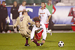 14 November 2008: Maryland's Drew Yates (falling) and Boston College's Alejandro Bedoya (16). The University of Maryland defeated Boston College 1-0 at WakeMed Stadium at WakeMed Soccer Park in Cary, NC in a men's ACC tournament semifinal game.