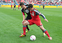 06 October 2012: D.C. United midfielder Lewis Neal #24 and Toronto FC defender Logan Emory #2 in action during an MLS game between D.C. United and Toronto FC at BMO Field in Toronto, Ontario..D.C. United won 1-0..
