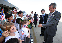 Harold Mayne-Nicholls (left) head of delegation meets young greeters during the arrival of the FIFA World Cup 2018-2022 inspection delegation to Washington D.C. at Dulles International Airport.
