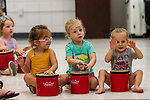 Prospect, CT. 17 July 2019-071719 - From left, Emma Odza, 3, of Prospect, Amelia Williams, 3, of Wolcott, and Ava Wilson, 2, of Cheshire bang on their drums making music, during a interactive presentation by Bob Bloom hosted by the Friends of the Prospect Library, at the Prospect Fire House in Prospect on Wednesday. Bill Shettle Republican-American