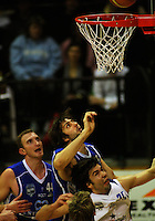 Kevin Owens beats Adrian Majstrovich to score as Nick Horvath (left) looks on during the NBL Round 14 basketball match between the Wellington Saints and Auckland Stars at TSB Bank Arena, Wellington, New Zealand on Thursday 29 May 2008. Photo: Dave Lintott / lintottphoto.co.nz