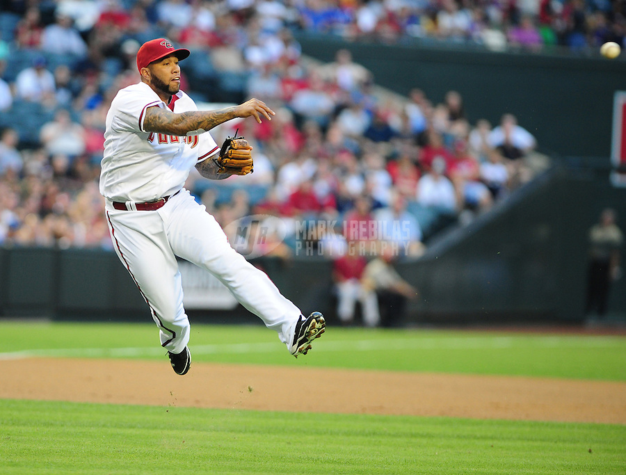 May 21, 2012; Phoenix, AZ, USA; Arizona Diamondbacks third baseman Josh Bell makes an off balance throw to first base in the second inning against the Los Angeles Dodgers at Chase Field.  Mandatory Credit: Mark J. Rebilas-