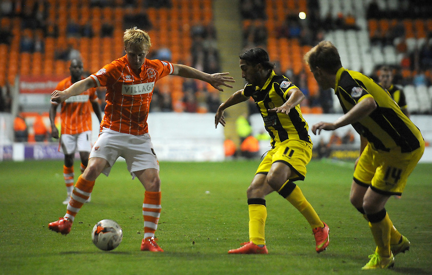 Blackpool's Mark Cullen under pressure from Burton Albion's Abdenasser El Khayati<br /> <br /> Photographer Kevin Barnes/CameraSport<br /> <br /> Football - The Football League Sky Bet League One - Blackpool v Burton Albion - Tuesday 18th August 2015 - Bloomfield Road - Blackpool<br /> <br /> &copy; CameraSport - 43 Linden Ave. Countesthorpe. Leicester. England. LE8 5PG - Tel: +44 (0) 116 277 4147 - admin@camerasport.com - www.camerasport.com