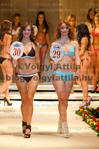 Monika Kocso (left) and Netti Paszti (right) attends the Miss Hungary 2010 beauty contest held in Budapest, Hungary on November 29, 2010. ATTILA VOLGYI