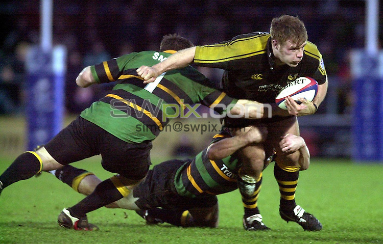 Pix: Matthew Lewis/SWpix.com. Rugby Union. Zurich premiership. London Wasps v Northampton Saints. 2/02/2003...COPYRIGHT PICTURE>>SIMON WILKINSON>>01943 436649>>..Wasps' Paul Volley is tackled by Northampton's Tom Smith.