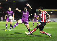 Lincoln City's Bruno Andrade crosses under pressure from Carlisle United's Jack Sowerby<br /> <br /> Photographer Andrew Vaughan/CameraSport<br /> <br /> The Emirates FA Cup Second Round - Lincoln City v Carlisle United - Saturday 1st December 2018 - Sincil Bank - Lincoln<br />  <br /> World Copyright © 2018 CameraSport. All rights reserved. 43 Linden Ave. Countesthorpe. Leicester. England. LE8 5PG - Tel: +44 (0) 116 277 4147 - admin@camerasport.com - www.camerasport.com