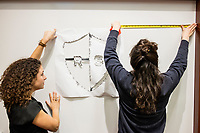 """Jesse Erin Posner (right), 31, and Arianna Grand, 27, put up Resistance School logo stencil on a whiteboard before a session of Resistance School  in the Starr Auditorium in the Belfer Building of Harvard University's John F. Kennedy School of Government, on Thurs., April 27, 2017. Posner works in Harvard's Department of Visual and Environmental Studies and serves as Production Designer for Resistance School. Grand is a Master in Public Policy grad student at Harvard's Kennedy School. Resistance School was started by progressive graduate students at Harvard after the Nov. 8, 2016, election of President Donald Trump. Resistance School describes itself as a """"practical training program that will sharpen the tools [needed] to fight back at the federal, state, and local levels."""" Resistance School puts on live lectures by leading progressives that are streamed and archived online alongside other information on the Resistance School website. During the lectures, teams of volunteers engage with followers on social media, including Facebook and twitter, sharing soundbytes, quotations, and supplementary materials as the lectures happen."""