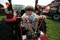 Cody Cason, 3, of Ferndale, checks out a backhoe at the NW Washington Fair. August 16, 2009 PHOTO BY MERYL SCHENKER            ..