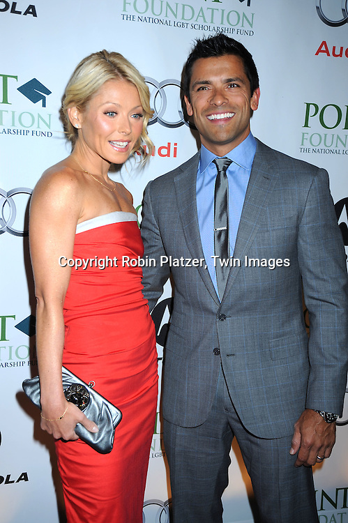 "Kelly Ripa and husband Mark Consuelos posing for photographers at the Point Foundations's Gala , ""Point Honors New York"" on April 19, 2010 at The Pierre Hotel in New York City. The Point Foundation is the nation's largest scholarship-granting organization for lesbian, gay, bisexua; and transgender students of merit."