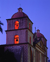 Exterior view of the Mission Santa Barbara; 'Queen of the Missions. Detail of the illuminated bell tower. Santa Barbara, California.