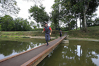 Rory MCILROY (NIR) runs over the footbridge from the 9th tee during Thursday's Round 1 of the 2014 PGA Championship held at the Valhalla Club, Louisville, Kentucky.: Picture Eoin Clarke, www.golffile.ie: 7th August 2014
