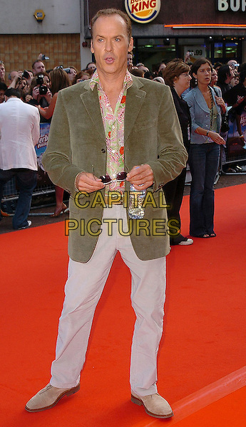 "MICHAEL KEATON.""Herbie: Fully Loaded"" UK Premiere, Vue West End, WC2..July 28th, 2005.full length green jacket green shirt beige jeans sunglasses shades funny evian bottled water.www.capitalpictures.com.sales@capitalpictures.com.©Capital Pictures"